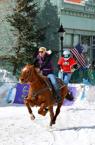 Fairplay's Jesslyn Swirka rides through downtown Leadville on Harrison Avenue during last year's skijoring contest. Swirka returns to the skijoring scene this season with three horses in the Minturn contest this weekend.