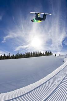 X Games champ Steve Fisher flies through Breck's halfpipe on opening weekend in 2013.