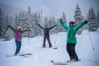 A Women's Wednesday group celebrates in the powder during a session at Copper Mountain last season. The season-long program pairs small groups of women with a dedicated instructor who helps the participants grow and progress through the season.