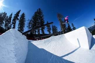 Germany's Silvia Mittermuller airs over the rail section at the World Cup slopestyle course in Spindleruv Mlyn, Czech Republic before the event March 18-20.