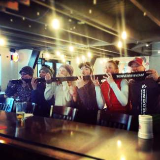 Arapahoe Basin Enduro challengers celebrate the end of a 10-hour day on Pallavicini Chair with a shotski at the A-Frame. This year's event includes the Enduro for 35 teams of two and a public apres party with dinner, a silent auction and more, all to raise funds for Flight for Life paramedic David Repsher, who was injured in a helicopter crash last July.