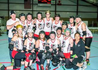The full 10th Mountain Roller Dolls crew after a game earlier this season. At 5 years old, the Eagle County-based roller derby team recently joined the elite Women's Flat Track Derby Association after an undefeated season in 2014.