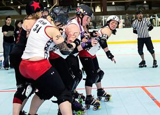 The 10th Mountain Roller Dolls (in white) line up for the start of a scoring play, known as a jam, in a recent bout. The Roller Dolls host the third-annual Melee in the Mountain roller derby tournament this Saturday in Eagle.