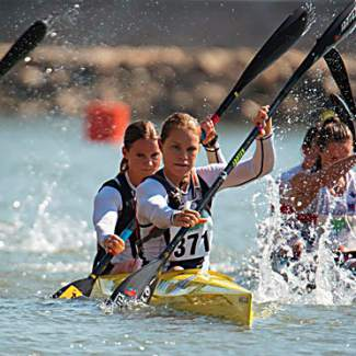 South African pro kayaker Michele Eray in the heat of a doubles race. Eray is a major proponent of training with technology, especially when working with high-level kayakers like Olympic hopeful Maggie Hogan of Team USA.