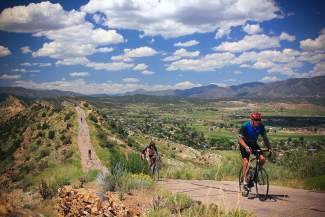Cyclist pedal along a route at the 2015 Ride the Rockies, an annual bike tour of passes and other scenic byways in the Colorado mountains. Front Range cyclist Tom Schwein and his team with Samaritan House return this year to raise money for homeless programs in Denver following Schwein's near-death experience at last year's event.