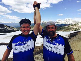 Cyclists Tom Schwein (left) and Kevin Dooley at the top of Cottonwood Pass during Cycle the Rockies, and annual bike tour through the Colorado Rocky Mountains. Schwein suffered a brain injury during a crash at the 2015 tour and returns this year when it passes through Summit County with his crew from Team Samaritan House June 13-15.