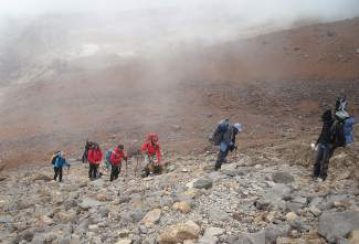 Multi-sport athlete Kyle Maynard, a Georgia native born with nearly amputated arms and legs, with a group of guides and fellow adaptive climbers on the trek to Mount Kilimanjaro in 2012. In the past few years, the champion wrestler and mixed martial arts fighter has expanded to hiking, deep-sea fishing and other high-adventure sports.