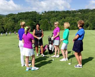 LPGA Hall of Famer Nancy Lopez (black shirt, facing) works with a small group of women during a women's-only clinic in Keystone last season. Lopez returns to Summit County for her signature series, Nancy Lopez Golf Adventures, from July 7-9.