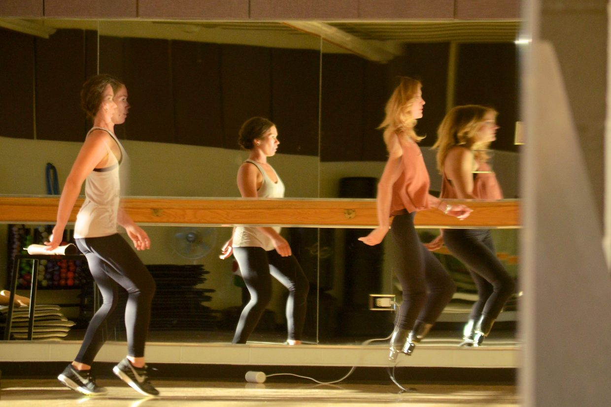 Dance coach Jessica Bellflower (left) watches Paralympic snowboarder Amy Purdy move through a solo dance routine in a mirror-lined studio at the Silverthorne rec center in August. The two were practicing for Purdy's performance at the 2016 Paralympic opening ceremony, a four-minute contemporary samba that requires two foot changes for the double amputee.