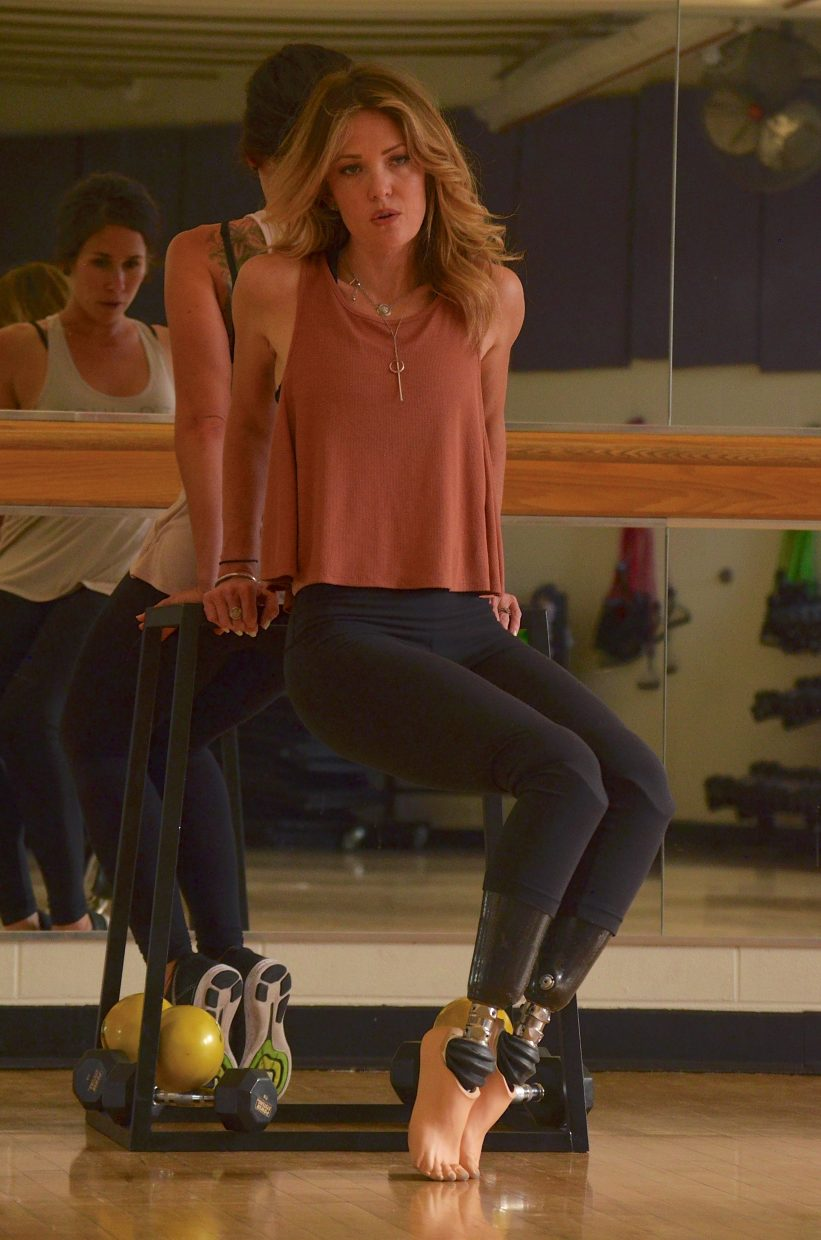 Paralympian Amy Purdy (front) practices her routine for the opening ceremony of the Rio 2016 Paralympics in a mirror-lined fitness room at the Silverthorne rec center with local dance coach Jessica Bellflower.