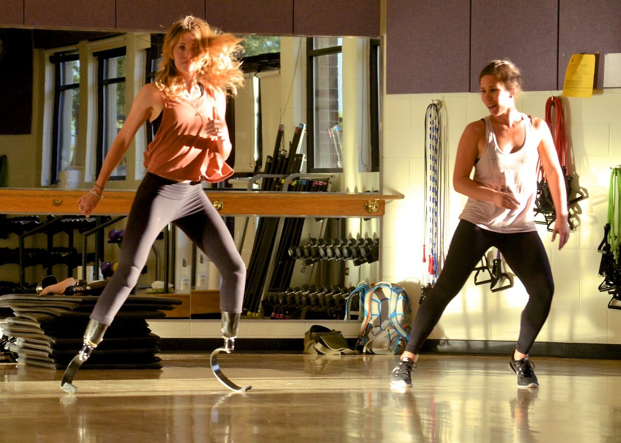 Paralympian Amy Purdy (left) practices a solo dance routine for the 2016 Paralympics on running blades with her dance coach, Jessica Bellflower of Frisco.