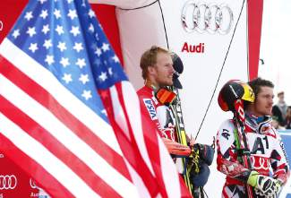 Ted Ligety, of the United States, center, winner of an alpine ski, men's World Cup giant slalom, stands on the podium next to third placed Marcel Hirscher, of Austria, right, in Soelden, Austria, Sunday, Oct. 25 2015. (AP Photo/Giovanni Auletta)