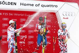 Ted Ligety, of the United States, center, winner of an alpine ski, men's World Cup giant slalom, celebrates on the podium with second placed Thomas Fanara, of France, left, and third placed Austria's Marcel Hirscher, in Soelden, Austria, Sunday, Oct. 25 2015. (AP Photo/Giovanni Auletta)