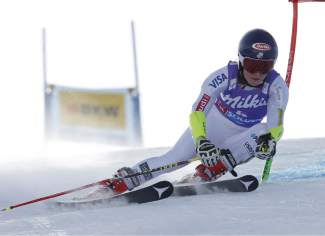 Mikaela Shiffrin, of the United States, skies past a gate during the first run of a Ski World Cup women's Giant Slalom in Soelden, Austria, Saturday, Oct. 24, 2015. (AP Photo/Alessandro Trovati)