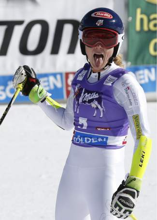 Mikaela Shiffrin, of the United States, celebrates her second place in the finish area after the second run of a Ski World Cup women's Giant Slalom in Soelden, Austria, Saturday, Oct. 24, 2015. (AP Photo/Alessandro Trovati)