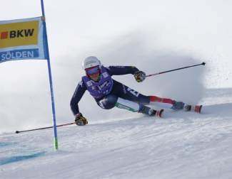 Italy's Federica Brignone skies past a gate during the first run of a Ski World Cup women's Giant Slalom in Soelden, Austria, Saturday, Oct. 24, 2015. (AP Photo/Alessandro Trovati)