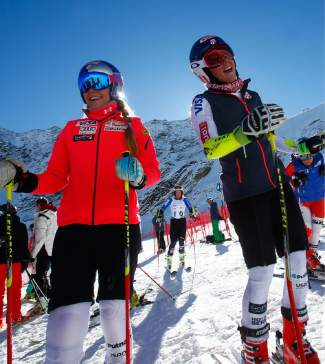 Lindsey Vonn, of the United States, left, and teammate Mikaela Shiffrin stand at the finish area at the Rettenbach glacier, ahead of Saturday's women's giant slalom Ski World Cup race in Soelden, Austria, Friday, Oct. 23, 2015. (AP Photo/Giovanni Auletta)