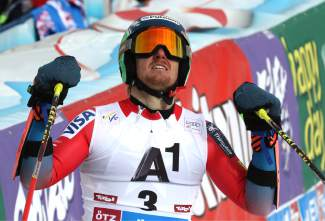 Ted Ligety, of the United States, celebrates in the finish area after winning an alpine ski, men's World Cup giant slalom, in Soelden, Austria, Sunday, Oct. 25 2015. (AP Photo/Marco Trovati)