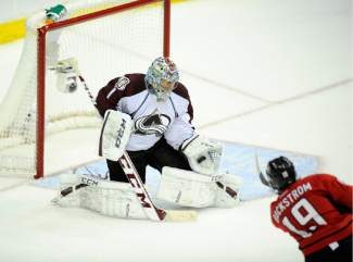 Colorado Avalanche goalie Semyon Varlamov (1), of Russia, makes a stop against Washington Capitals center Nicklas Backstrom (19), of Sweden, during the third period an NHL hockey game, Saturday, Oct. 12, 2013, in Washington. The Avalanche won 5-1. (AP Photo/Nick Wass)