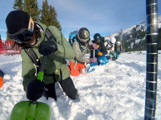 Participants in a female-only avalanche clinic practice digging technique at Copper Mountain. Colorado Mountain College offers year-round avalanche training and other courses for outdoor professionals.