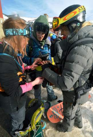 Sherry McConky (right) of the SAFE AS avalanche clinic series helps two snowboarders work with an avalanche beacon at Copper Mountain. Professors with the outdoor education program at Colorado Mountain College suggest taking basic courses before planning a backcountry trip.