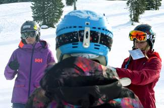 A participant in the SAFE AS avalanche course watches as two pro skiers, Jackie Paaso (left) and Elyse Saugstad (right), go over how to use avalanche beacons. The two travel the country teaching female-only avy clinics early in the season.