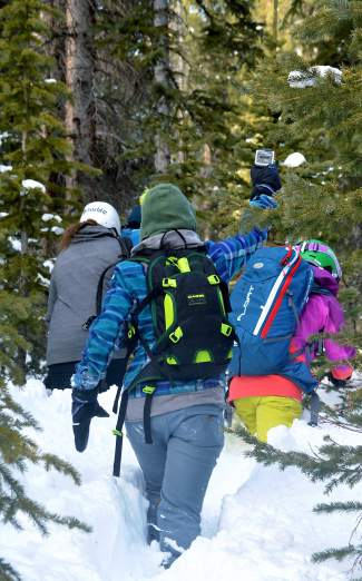 Participants in the SAFE AS avalanche clinic head into the woods to practice beacon drills at Copper Mountain Dec. 19. The female-only clinic drew 60 aprticipants from across the state and region.