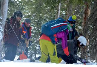 Participants in the female-only SAFE AS avalanche clinic practice retrieving beacons in deep snow at Copper Mountain on Dec. 19. The series gives top-level pros the chance to connect with and educate other women interested in backcountry skiing and snowboarding.