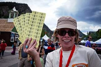 Volunteer Deborah Wohlmuth sells tickets during a past Colorado Barbecue Challenge in Frisco. The town is currently seeking about 350 volunteers to help during this year's event, which is expected to attract 25,000 to 30,000 hungry visitors.
