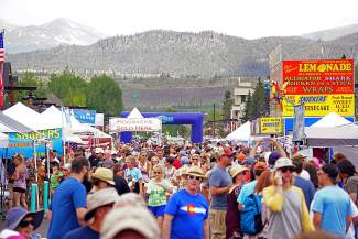 Crowds fill Main Street in Frisco to enjoy the food offered by 70 teams from across the country competing in the Colorado BBQ Challenge June 17, 2016.