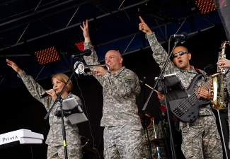 The 101st Army Rock Band performs on stage at the corner of Madison Avenue & Main Street in Frisco during the Colorado BBQ Challenge Friday, June 17.