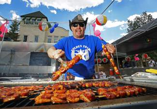 Mike Stall of Highlands Ranch mans the grill at Golden Toad during the Colorado BBQ Challenge in Frisco Friday, June 17, 2016.
