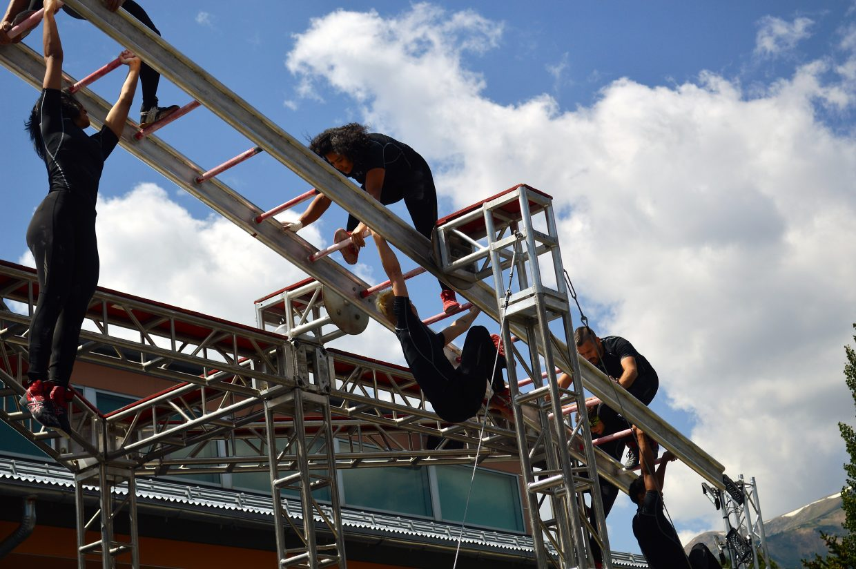 "In ""Ascension,"" dancers scaled a rotating ladder in front of the Riverwalk Center."