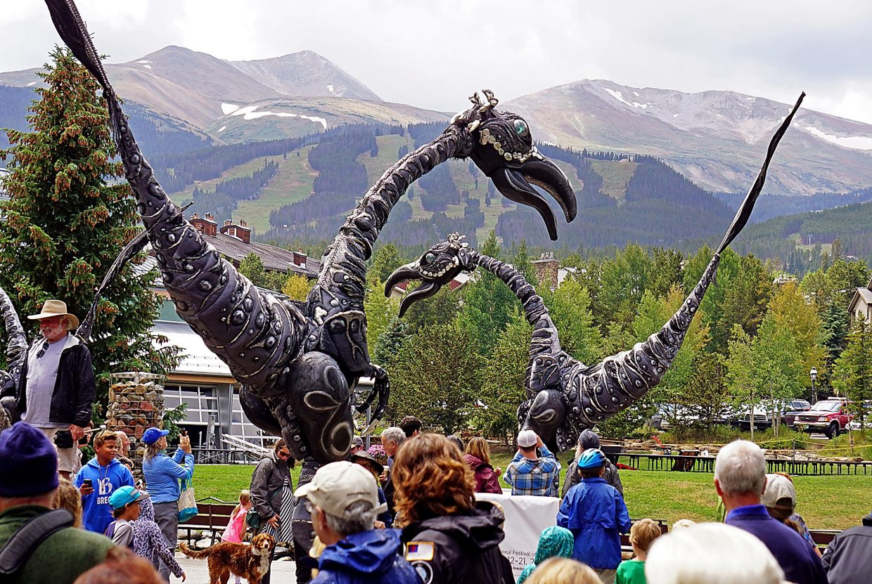 The Dutch street theatre act Saurus, which includes performers on stilts and 18-foot dinosaur costumes, interacts with the crowd as part of the Breckenridge International Festival of Arts Friday, Aug. 19, 2016.