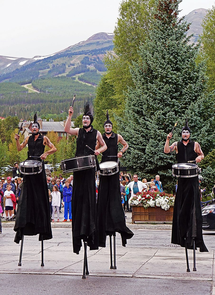 Drummers from the group STX walk on stilts as they perform for a crowd in Blue River Plaza in Breckenridge Thursday, Aug. 18, 2016.