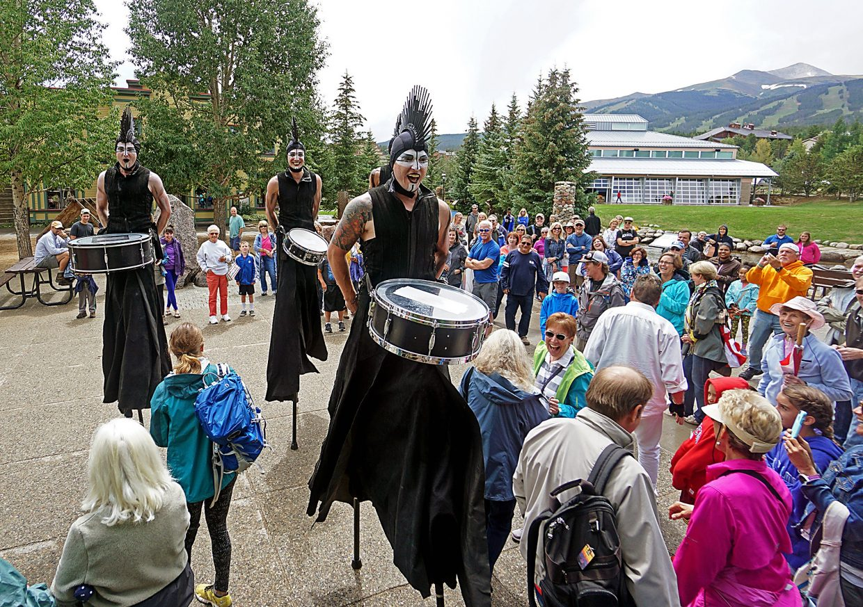 Drummers from the group STX walk on stilts through a crowd in Blue River Plaza in Breckenridge during a performance Thursday, Aug. 18, 2016.