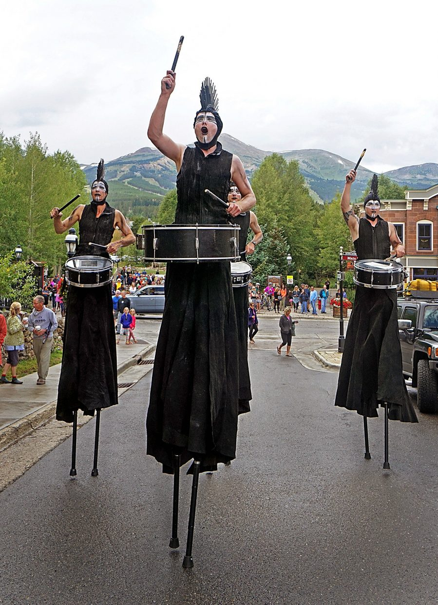 Drummers from the group STX walk on stilts up Washington Avenue in Breckenridge during a performance Thursday, Aug. 18, 2016.