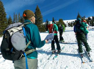 Joanna Doxey compares the map to the territory during the Backcountry Babes avalanche clinic in early January outside of Breckenridge.