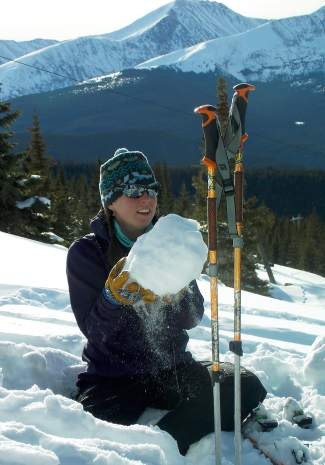 Instructor Anne St. Clair teaches a group about the snowpack and how to identify snow layers on Mount Baldy outside of Breckenridge.