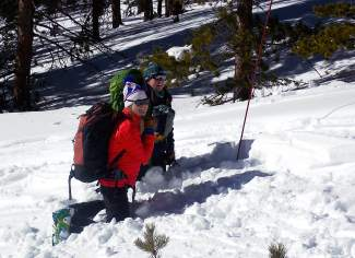 Instructors Anne St. Clair (right) and Katie Damby (left, near) with Backcountry Babes practice companion rescue at Mount Baldy, a mellow backcountry area found east of Breckenridge.