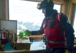 Ski patroller Louis Skowyra explains avalanche explosives in Patrol Headquarters at the summit of Arapahoe Basin. Snow safety patrollers like Skowyra use five-pound hand explosives for the majority of avalanche mitigation at the 960-acre resort.