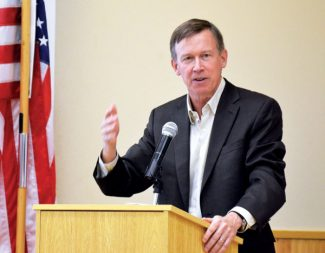 In this file photo from October 2012, Gov. John Hickenlooper speaks on forest health issues and Summit County wildfire management and mitigation at the Summit County Community and Senior Center in Frisco.
