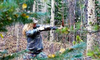 The author learns to deal with natural obstacles and other distractions while bow hunting in Summit County.