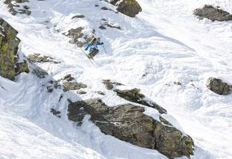 Team Summit's Pierce McCrerey reaches for a grab after airing off a rock formation during the qualifiying round of the GoPro Big Mountain Challenge on Peak 6 in 2015. The event returns to Peak 6 this weekend with 170 athletes from across the region, including athletes from Team Breckenridge and Team Summit.