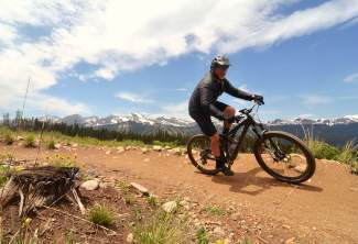 Breckenridge mayor Eric Mamula whips through a berm in a meadow high above Carter Park on the Barney Ford trail during a lunch loop ride for Breck Bike Week in June 2016.