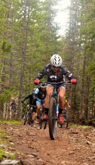 Local XTERRA athlete Jaime Brede powers up the loose rock of Nightmare on Baldy trail during a lunch loop ride led by mayor Eric Mamula for Breck Bike Week in June.