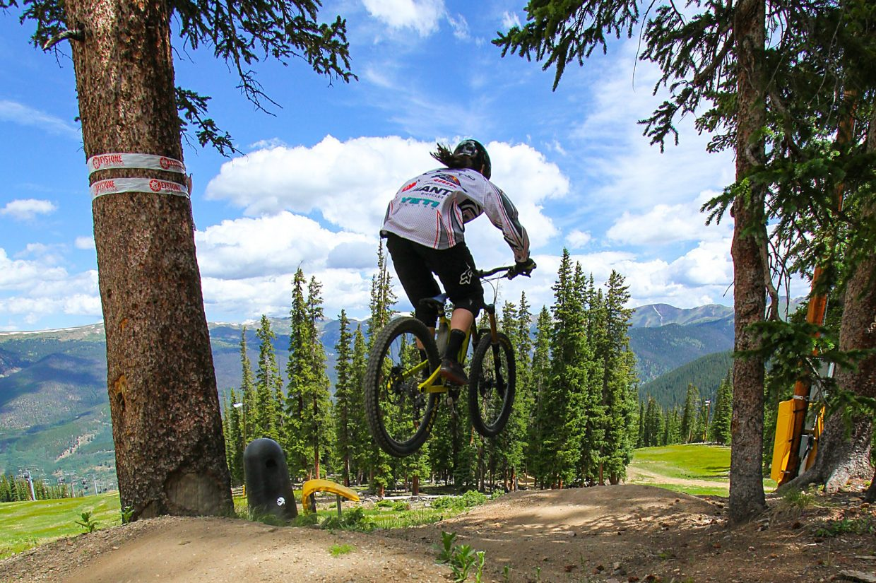 Downhiller Alyson Cockrell hits a jump near the top of Summit Express lift at the Keystone Bike Park. The park is home to 55 miles and 55 trails, all accessible by the chairlift.