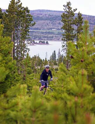 Grinding through pine stands on the Frisco Peninsula trail system in late May, with views of Frisco Bay Marina in the background.