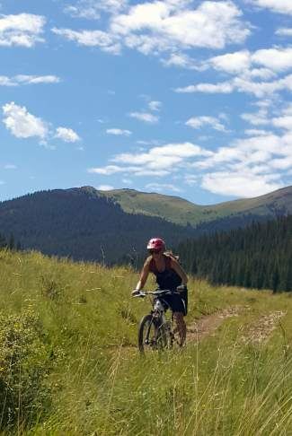 Remote wetland meadow riding on the Penn Gulch Grind mountain bike course in Breckenridge, CO.