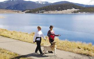 Two sisters enjoy a walk along the Lake Dillon recreation path. The 18-mile route is paved throughout and perfect for an afternoon of cycling or simply walking with the family.